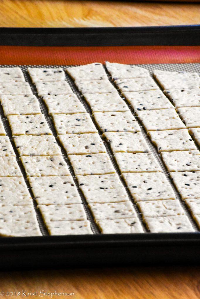 Cracker dough rolled out, cut