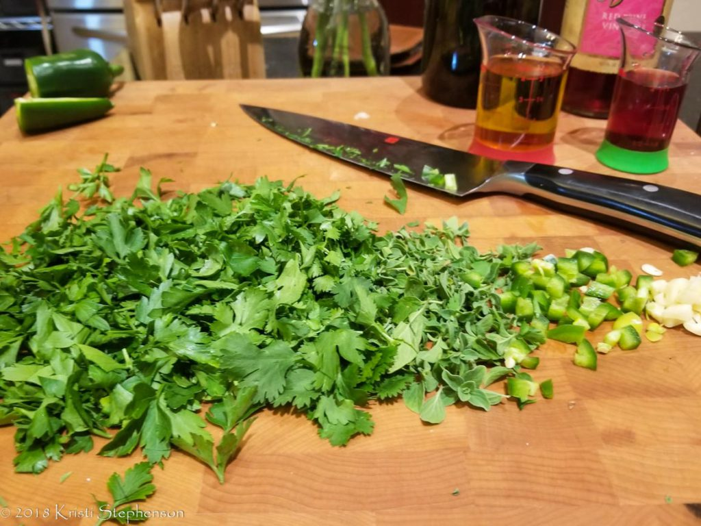 Prepping chimichurri sauce