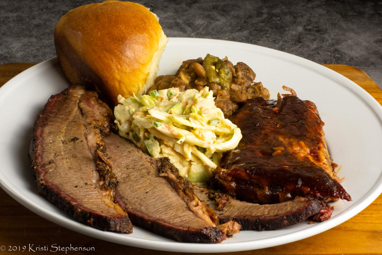 Brisket, ribs, coleslaw, spicy baked beans, sourdough roll - Plated and ready to enjoy!